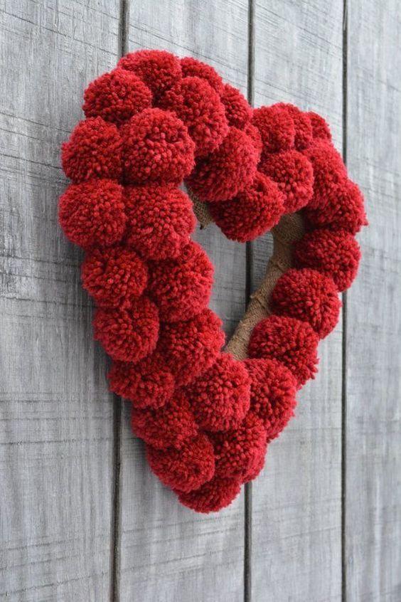Corazón de pom pom